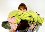 woman carrying clothes